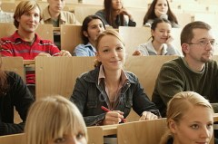 Blonde woman smiling in college class