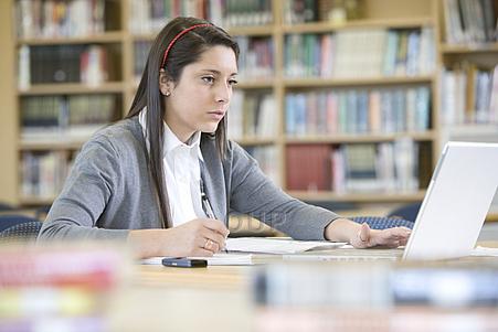schoolgirl-using-laptop