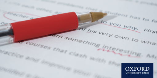 red pen lying on writing, which has been underlined