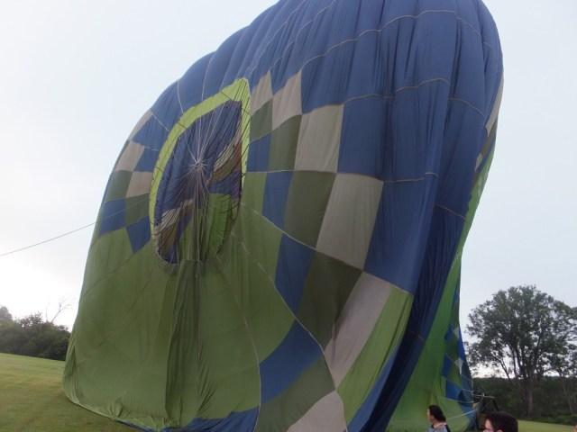 Deflating the balloon.