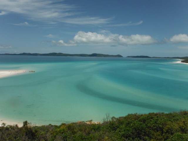 Swirling blue and turquoise of Whitehaven Beach with the tide in.