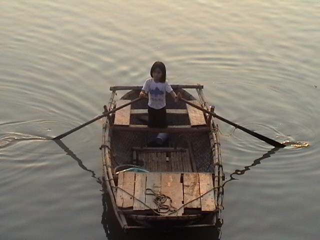 Mekong River, child rowing