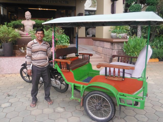 Here's Sok, our champion tuk-tuk driver out the front of our hotel