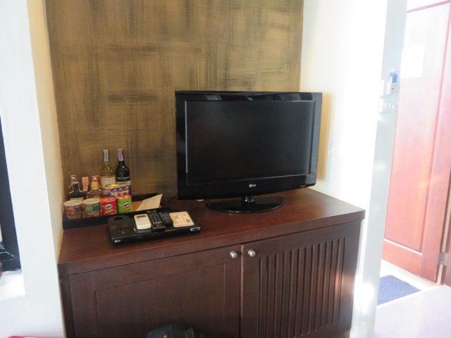 The bar fridge is underneath the TV, restocked daily.