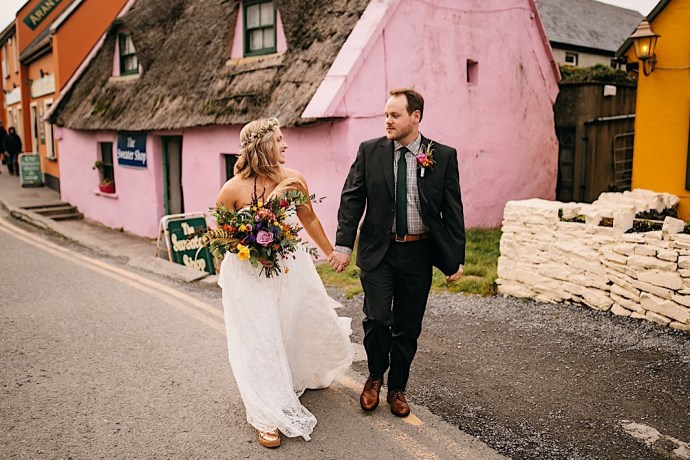 Bride and groom in front of famous pink house in Doolin Ireland shot by Chattanooga photographer Our Ampersand Photography