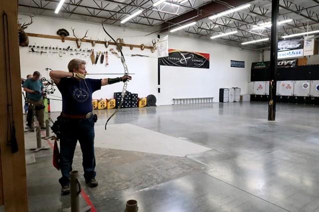 Becky aiming down range.