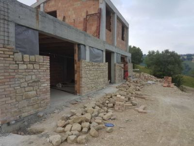 Back Wall showing stone work on a new house in Le Marche