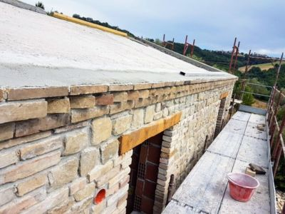 Brick Detail Below Roof of a new house being built in Le Marche, Italy