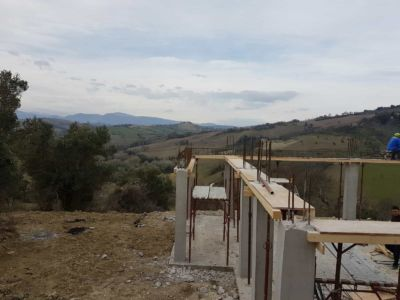 Starting the Supports of the Top Floor Base On a new house construction in Le Marche