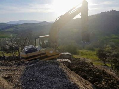 Compacting and Leveling Behind House being constructed in Le Marche