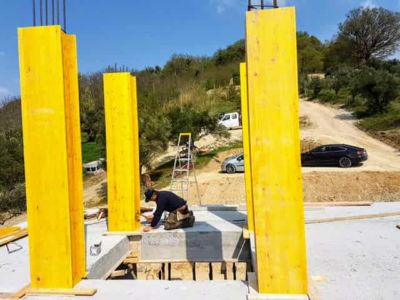 Concrete Forms for Top Floor Columns at new house construction site in Le Marche