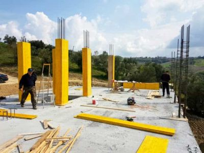 Connecting Top Floor Steel at new house construction site in Le Marche