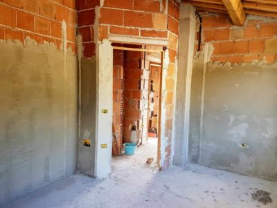 Emma's Room Toward Hall inside a new house being built in Le Marche