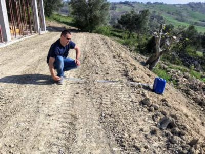 Flat Extends 3m Past Blue Can at house being constructed in Le Marche