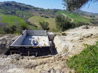 Leveling Area Near Pool at new house being constructed in Le Marche