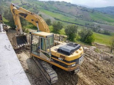 Leveling Behind and South of House at new house construction site in Le Marche