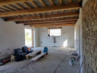 Main Room with Stone Wall inside a new house in Le Marche