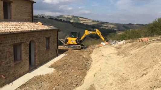 More Gentle Slope in Front at the site of new construction in Marche
