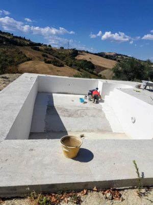 Pool Sealant Being Applied on a pool behind a new house in Le Marche