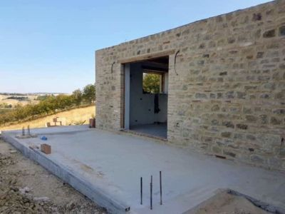 Portico Base Poured behind a new stone house in Le Marche, Italy