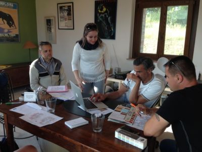Primo, Alessandra, Kevin, and Francisc in a design planning meeting for a new house in Le Marche