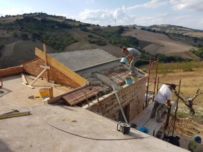 Putting Poroton in Place for Roof Section at a new building site in Le Marche, Italy