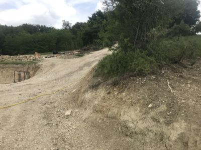 Stone on Neighbors Land  at site of a new house being built in Le Marche, Italy