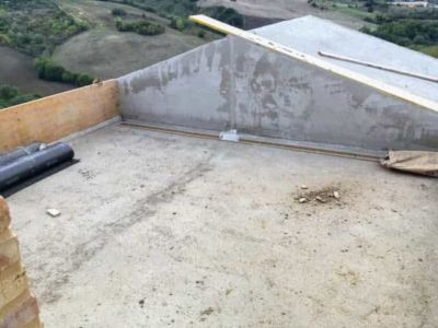 Terrazza with Roof Over Kitchen at a new building site in Le Marche, Italy