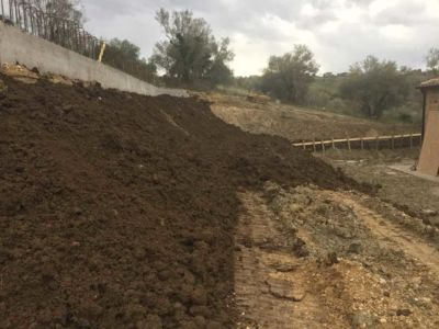 Topsoil over Terra Armata in front of a new house being built in Le Marche, Italy