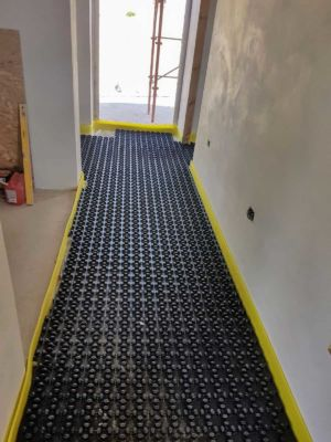 Underfloor Heating Base Layer in Main Hall of a new house in Le Marche