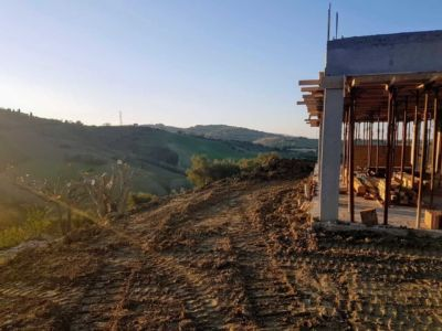 Working Behind the House at new house being constructed in Le Marche