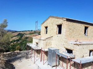 Stone House with Roof being built