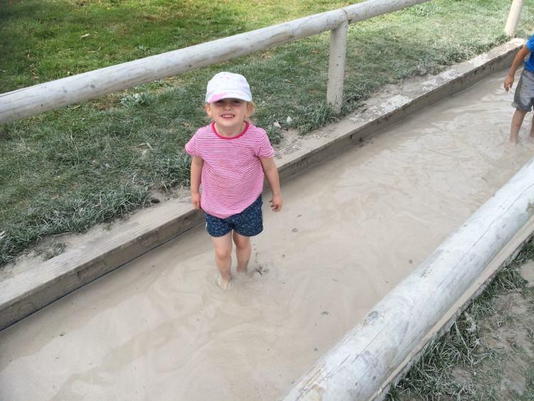 Trentham gardens, girl barefoot in mud