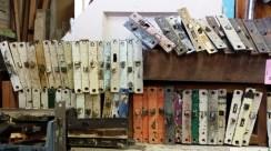 Rows od Eastlake mortise locks painted diferent colors