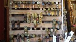 Ornate antique door hardware hanging on a wood pallet
