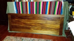 African mahogany footbaord with light and dark ribbons in the grain