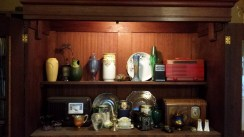 Vintage radios and china in armoire