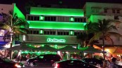 Mimo building the Pelican, lit in green neon