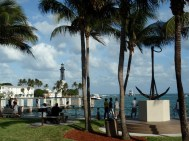 Park with palm trees and view of Hillsboro Inlet Light