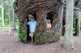 Man and woman in woven willow structures