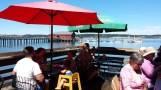 Lunch under deck umbrellas with view of Coupeville, Wash. warf