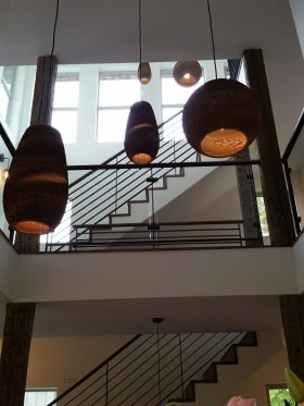 Recycled cardboard hanging lamps light an open stairwell