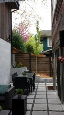 Deep courtyard between house and retaining wall