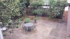 Brick patio with plantings