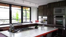 Dark cabinets and light ganite counters in modern kitchen