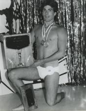 Mr. Gay All-American 1986 Ered Matthew poses for photographers moments after claiming victory at the third annual contest held in Little Rock in 1985.