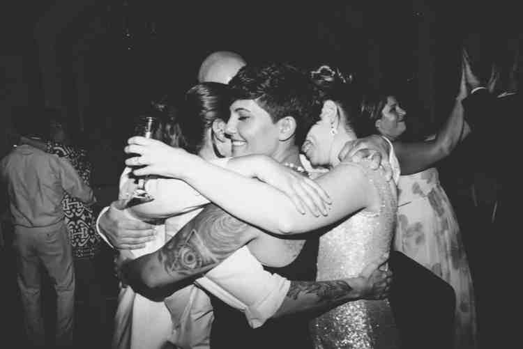 Same sex orlando wedding roup hug at The White Room