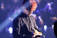 Baekhyun in a black suit holding a stuff-doggie