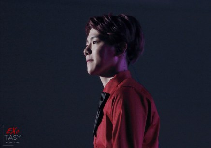 Baekhyun in a red shirt with a bow tie