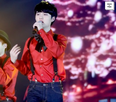 D.O. in a red shirt with a bow tie and suspenders